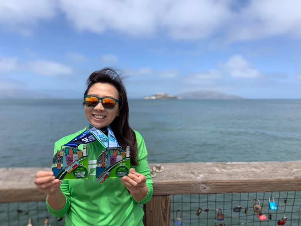May Chih with her medals for completing the San Francisco Ultramarathon