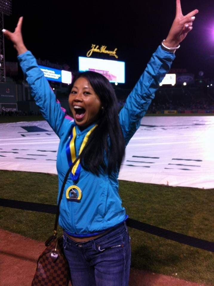 Lindsay with Boston Marathon medal and jacket