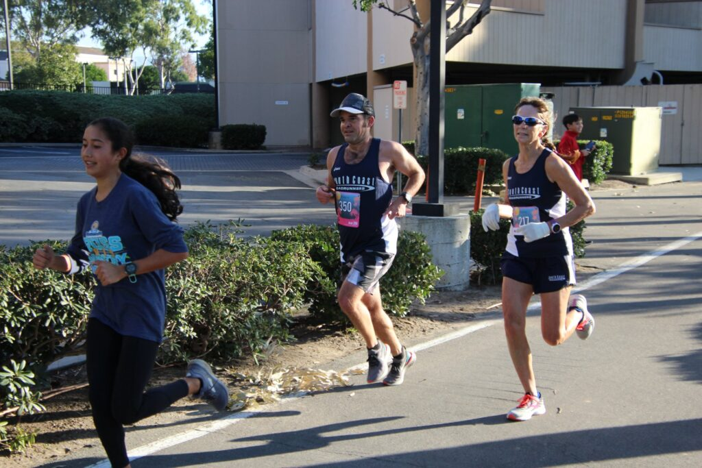 Sherri and Ryan racing in the Irvine Half Marathon 5K
