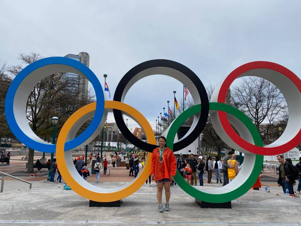 Michelle in front of the Olympic rings