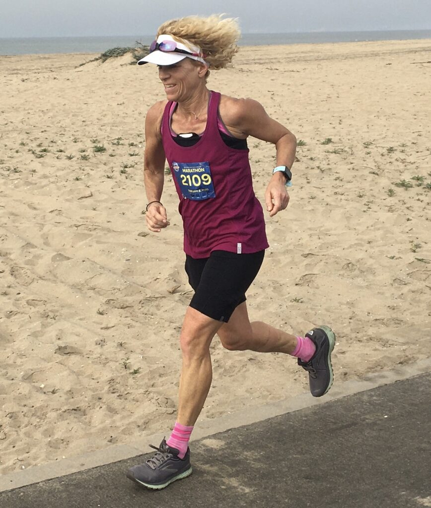 Jen running the Surf City Marathon