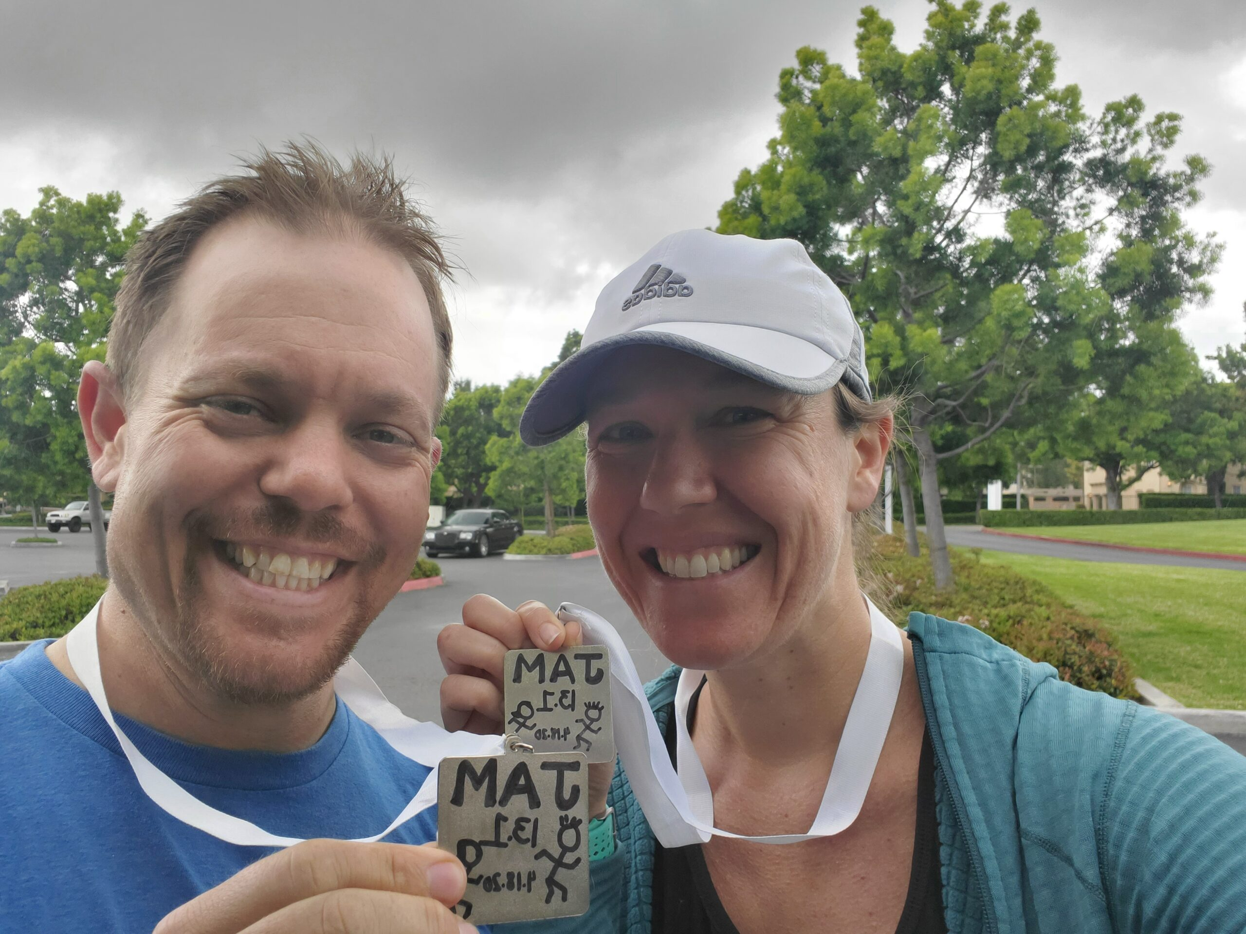 Justin and Margot with their homemade finishers medals