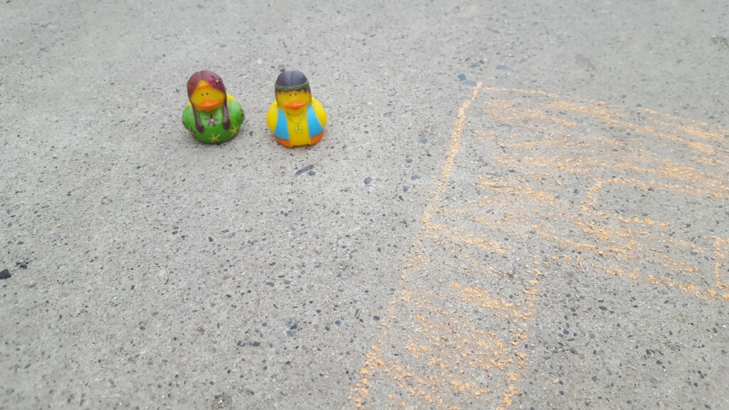 Hippy rubber duckies on the pavement