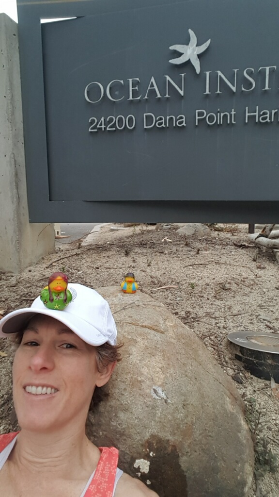 Nicole and rubber duckies in front of Dana Point Ocean Institute