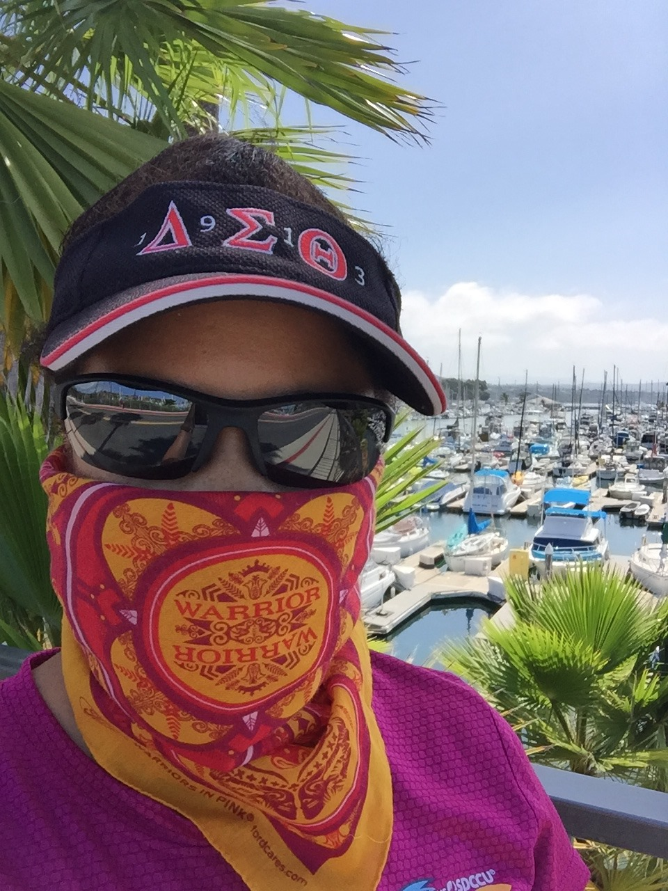 Linda Hammond at Dana Point Harbor wearing a bandana over her nose and mouth
