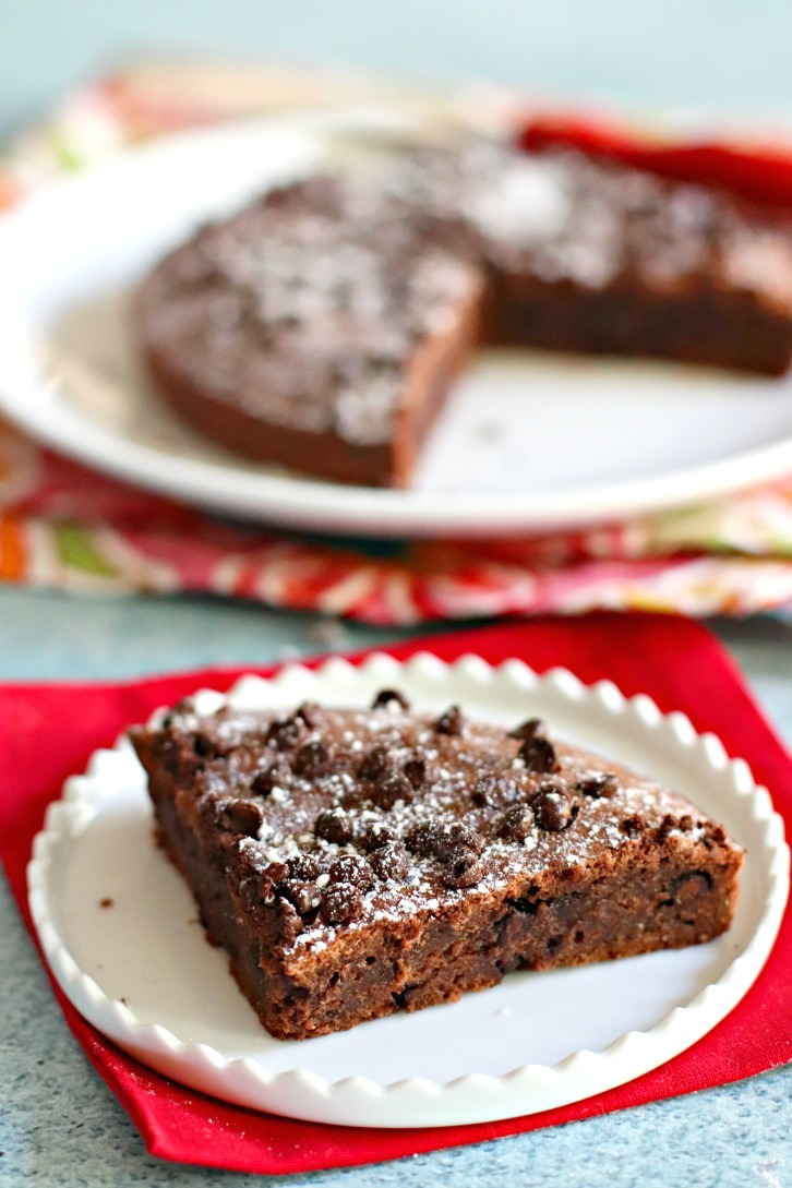 Brownie topped with chocolate chips and powdered sugar