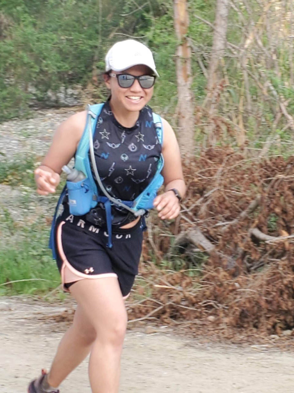 Michelle running on a trail
